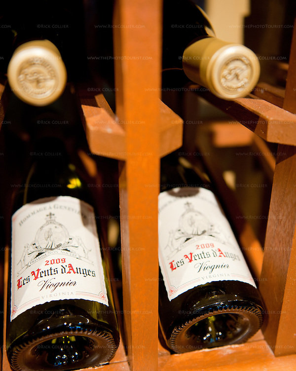 Bottles of viognier for sale, on display in the rack at Keswick Vineyards.