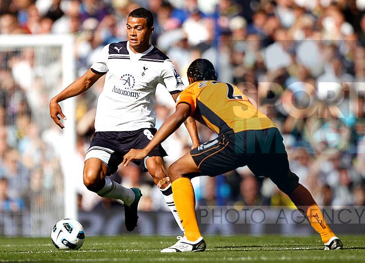 Jermaine Jenas of Tottenham Hotspur takes on Michael Mancienne of Wolverhampton Wanderers