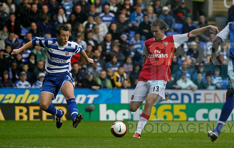 Arsenal's Aleksandr Hleb (R) scores his side's second goal.