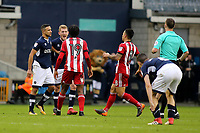 Millwall's George Saville and Romaine Sawyers of Brentford exchange views after Referee, Stuart Attwell blows the whistle at the end of the match during Millwall vs Brentford, Sky Bet EFL Championship Football at The Den on 10th March 2018