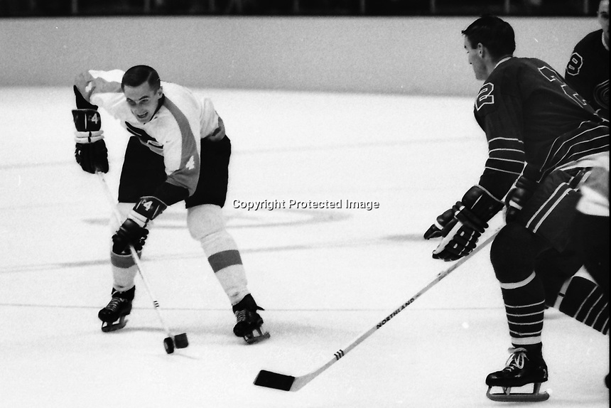 Philadelphia Flyer John Miszuk against California Golden Seals Bob Lemieux. (1967 photo/Ron Riesterer