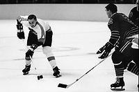 Philadelphia Flyer John Miszuk against California Golden Seals Bob Lemieux. (1967 photo/Ron Riesterer