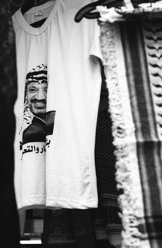 A t-shirt bearing an image of Yasser Arafat hangs in the souk of Nablus' Old City, the occupied West Bank, February 2006. Photo: Ed Giles.