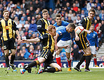 Fraser Aird heads in the opener for Rangers