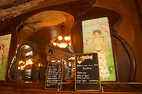 The menu on a chalk black board blackboard chalkboard with Lillet written on it with this month's special offers on wine. On the wall a painting of a nymph, half naked young girl, on tiles, and wooden panelled walls. A big mirror reflecting the bar and the chandelier The Bistrot du Peintre is an old fashioned Paris café cafe bar restaurant of art nouveau design with polished brass, mirrors and old signs