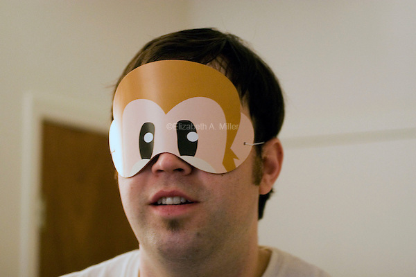 A man in a monkey mask.