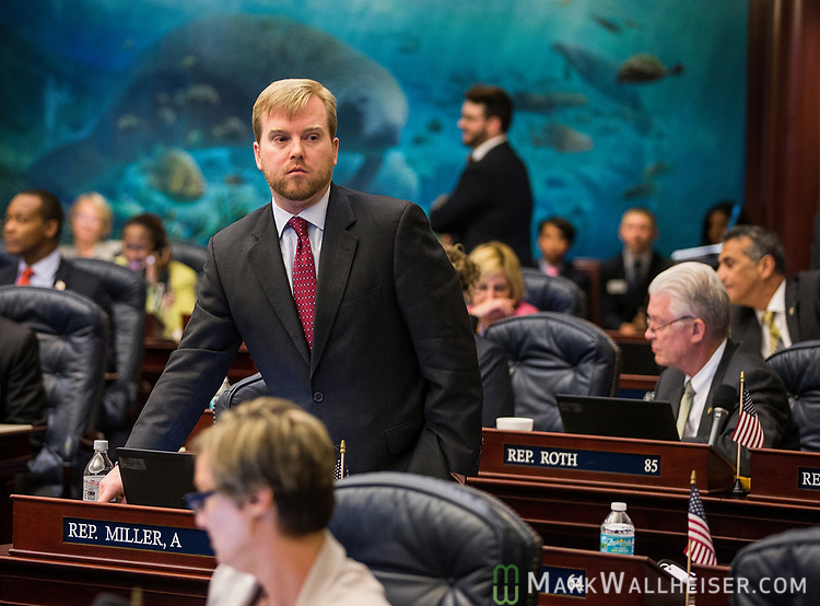 Rep. James Grant, R-Tampa, votes during Florida House of Representatives floor debate at the Florida Capitol in Tallahassee, Florida.