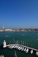 Wide angle view of Venice, in the foreground the marina on the island of San Giorgio Maggiore. Venice, Italy. May 2007.