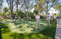 Golf Coach Andrew Larkin and his team use the new putting green on the Occidental College campus on March 26, 2015. The outdoor facility may be called: Andrew E. Rubin Practice Facility, including the Pongracz and Wright Families Putting Green & Tiger Golf Hitting Bays.<br /> (Photo by Marc Campos, Occidental College Photographer)