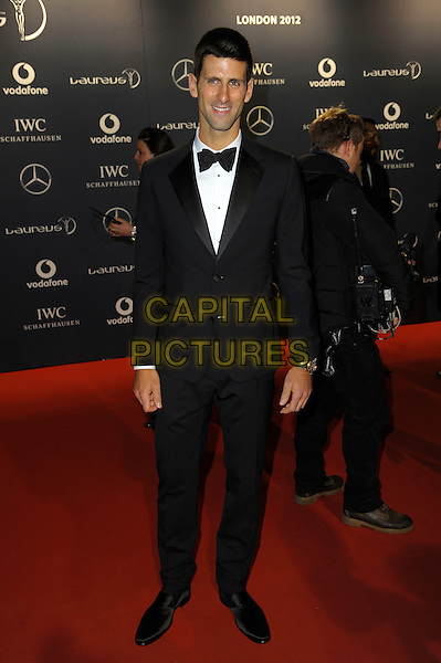Novak Djokovic.Arrivals at the Laureus 2012 World Sports Awards held at the Queen Elizabeth II Centre, London, England..February 6th, 2012.full length black tuxedo .CAP/CAS.©Bob Cass/Capital Pictures.