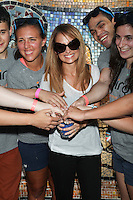 Nicole Richie celebrates the Bing summer of Doing with dosomething.org by volunteering and restoring CITYarts Mosaic Peace Wall. Harlem, New York. July 10, 2012 © Diego Corredor/MediaPunch Inc.