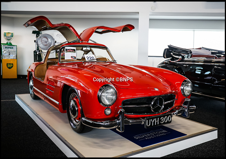BNPS.,co.uk (01202 558833)<br /> Pic: SilverstoneAuctions/BNPS<br /> <br /> First up - 1954 SL300 gullwing sold for £832,000...<br /> <br /> British collecter in Million pound double swoop on two super rare 'Gullwing' Mercedes at classic car auction.<br /> <br /> Two distinctive Mercedes 'Gullwing' cars have sold for over £1m - to the same buyer.<br /> <br /> One of the motors was a classic 1954 coupe, the Mercedes SL300 Gullwing, that went under the hammer for a whopping £832,000.<br /> <br /> The other, a modern 2010 Mercedes SLS AMG which had done only 690 miles, fetched over £203,000.<br /> <br /> The Mercedes SL300 Gullwing was an instant hit on its release thanks in part to its iconic lifting doors.<br /> <br /> Around 1,400 Gullwings were made between 1954 and 1963, the vast majority of which were exported to the US.