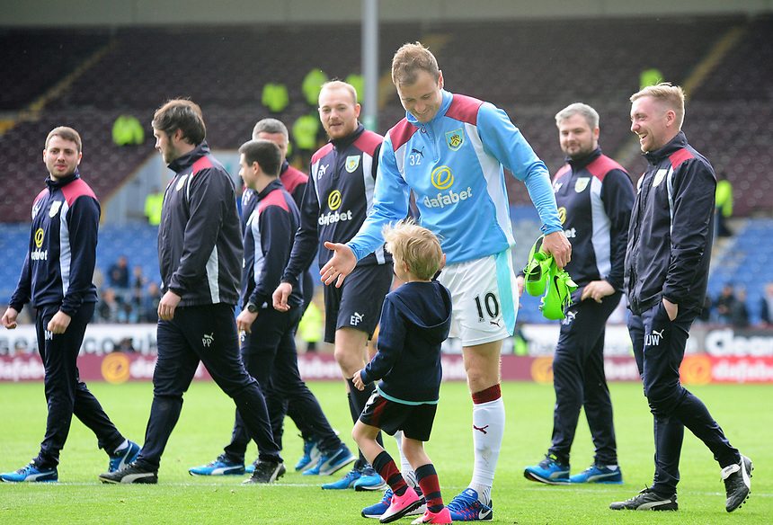Burnley's Ashley Barnes high fives his young child at the end of the season lap of honour<br /> <br /> Photographer Andrew Vaughan/CameraSport<br /> <br /> The Premier League - Burnley v West Ham United - Sunday 21st May 2017 - Turf Moor - Burnley<br /> <br /> World Copyright &copy; 2017 CameraSport. All rights reserved. 43 Linden Ave. Countesthorpe. Leicester. England. LE8 5PG - Tel: +44 (0) 116 277 4147 - admin@camerasport.com - www.camerasport.com