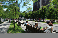 Montreal (QC) CANADA - June 7, 2012 - Victoria Square at lunch time.