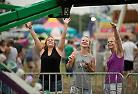 NWA Democrat-Gazette/BEN GOFF @NWABENGOFF<br /> Cassandra Carter (from left), sister Samantha Carter and ther mother Connie Carter of Gravette wave as Cassandra's daughter Rebecca swings by on a ride Saturday, Aug. 12, 2017, on the final day of the Benton County Fair in Bentonville.