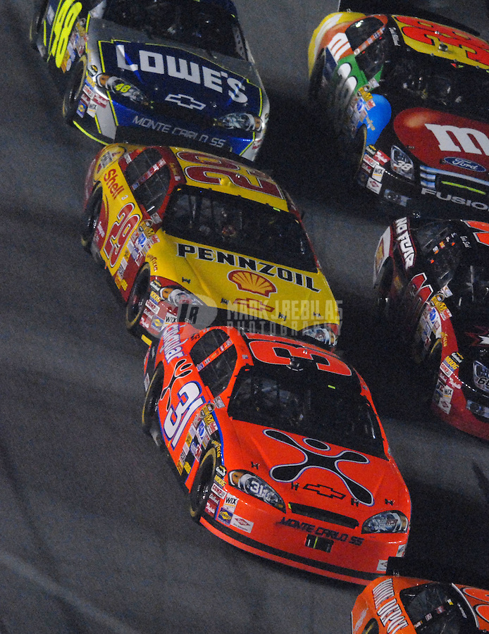 Feb 10, 2007; Daytona, FL, USA; Nascar Nextel Cup driver Jeff Burton (31) leads teammate Kevin Harvick (29) through traffic during the Budweiser Shootout at Daytona International Speedway. Mandatory Credit: Mark J. Rebilas