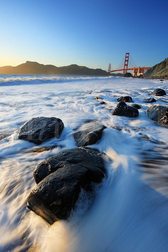 Golden Gate Bridge and surf on Marshall Beach rocks, Golden Gate National Recreation Area, San Francisco, California, USA, North America