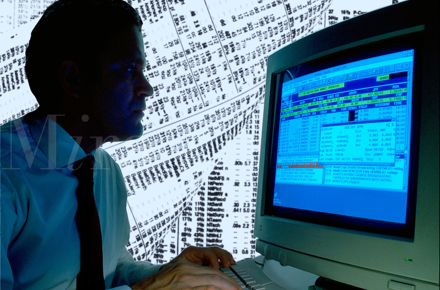 Businessman working at a computer with stock price.