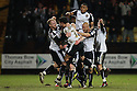 Jeff Hughes of Notts County is mobbed by team-mates after  scoring the winning goal.  Notts County v Stevenage - npower League 1 - Meadow Lane, Nottingham - 22nd February, 2012. © Kevin Coleman 2012
