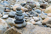 Rocks placed on top of one another along the East Branch of the Pemigewasset River, near the Riverwalk Trail, in Lincoln, New Hampshire.