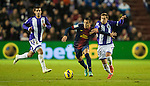 VALLADOLID, SPAIN - DECEMBER 22:  Alexis Sanchez (C) of FC Barcelona runs with the ball during the La Liga game between Real Valladolid and FC Barcelona at Jose Zorrilla on December 22, 2012 in Valladolid, Spain. Photo by Victor Fraile / The Power of Sport Images
