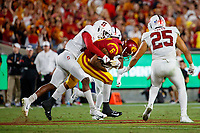 LOS ANGELES, CA - SEPTEMBER 8: Stanford Cardinal cornerback Paulson Adebo #11 tackles USC Trojans wide receiver Michael Pittman Jr. #6 during a game between USC and Stanford Football at Los Angeles Memorial Coliseum on September 7, 2019 in Los Angeles, California.