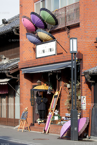"February 14, 2013, Kawagoe, Japan - A woman sells umbrellas on the principal street of Little Edo, Kawagoe. An old town from Edo Period (1603-1867) is located in Kawagoe, 30 minutes by train from central Tokyo. In the past Kawagoe was an important city for trade and strategic purpose, the shogun installed some of their most important loyal men as lords of Kawagoe Castle. Every year ""Kawagoe Festival"" is held in the third weekend of October, people pull portable shrine during the parade, later ""dashi"" floats on the streets nearby. The festival started 360 years ago supported by Nobutsuna Matsudaira, lord of Kawagoe Castle. (Photo by Rodrigo Reyes Marin/AFLO).."