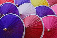 Decorative umbrellas hand made by local artist at Umbrella Making Center,.Bo Sang, just outside Chiang Mai, Thailand.