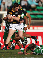 Wellington hooker Dane Coles is tackled by Aaron Smith (obscured) during the Air NZ Cup preseason match between Manawatu Turbos and Wellington Lions at FMG Stadium, Palmerston North, New Zealand on Friday, 17 July 2009. Photo: Dave Lintott / lintottphoto.co.nz