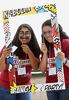 NWA Democrat-Gazette/DAVID GOTTSCHALK   Raquel Romero (left), a senior at the University of Arkansas, and Maria Arandia, a sophomore, pose with glasses and a frame Friday, August 11, 2017, as they are photographed on the north terrace of the Union Courtyard on the campus in Fayetteville. The summer themed photo booth was sponsored by University Programs and included light snacks.