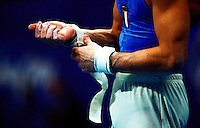 Gymnast taping his wrist before competing