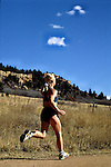 Woman trail running in Palmer Lake