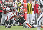 Tampa Bay Buccaneers running back Carnell Williams breaks free from Cleveland Browns safety T.J. Ward for a first down in the second half. The Buccaneers defeated the Browns 17-14 in the opening NFL regular season game Sunday, Sept. 12, 2010 in Tampa,Fla. (AP Photo/Margaret Bowles)