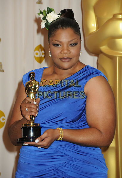 MO'NIQUE (Monique Imes).82nd Annual Academy Awards held at the Kodak Theatre, Hollywood, California, USA..March 7th, 2010.oscars  award trophy winner half length blue dress  flower in hair .CAP/ADM/BP.©Byron Purvis/AdMedia/Capital Pictures.