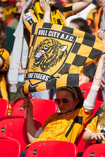 13.04.2014.  London, England.  Hull City fan using her flag as a sunshade before  the FA Cup Semi-Final between Hull City and Sheffield United from Wembley Stadium.