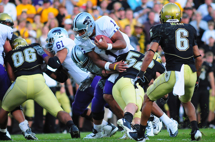 18 October 08: Kansas State quarterback Josh Freeman tries to get out of a tackle by Colorado linebacker Brian Stengle (52) as he rushes against Colorado. The Colorado Buffaloes defeated the Kansas State Wildcats 14-13 at Folsom Field in Boulder, Colorado.