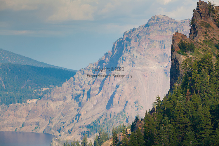 Crater Lake National Park, the only National Park in the state of Oregon, attracts some 482,000 people annualy. The lake itself is 592 meters (1,943ft) deep and is the deepest lake in the United States.  The park was founded in 1902 and seeks to preserve the natural and cultural resources.  Crater Lake lies in a caldera, or volcanic basin, created when Mt. Mazama collapsed around 7,700 years ago.  The clarity and blueness of the water are unique to this geologic area.  The lake is filled almost entirely by melted snow.  The lake is only accessibly by one trail, the Cleetwood Cove Trail, which leads down to the water for access to the tourist boats.  Tourists risking their life for a better view by climbing onto a precipice.