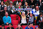 Stockholm 2014-05-03 Ishockey Oddset Hockey Games  Sverige - Finland :  <br /> Finland supportrar med en halsduk och en flagga<br /> (Foto: Kenta J&ouml;nsson) Nyckelord:  Oddset Hockey Games Sverige Swe Tre Kronor Finland Fin Globen Ericsson Globe Arena supporter fans publik supporters