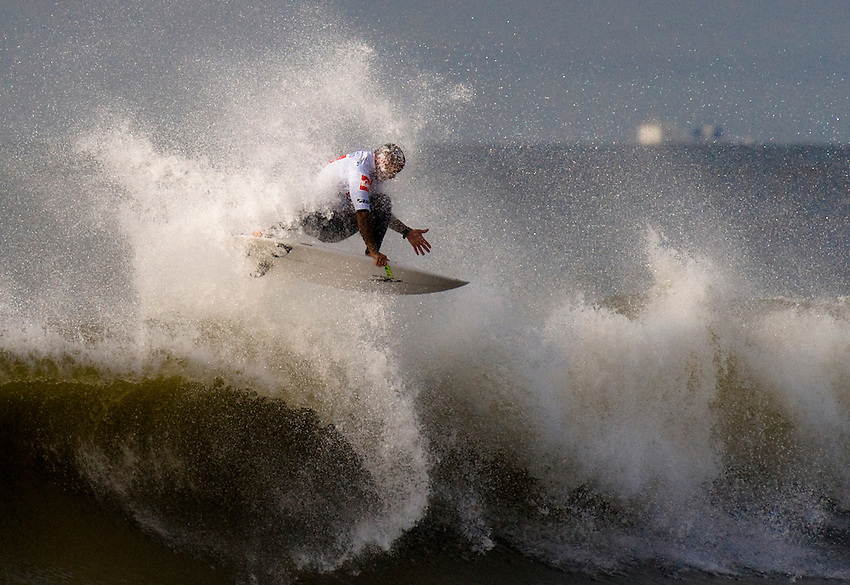 Raoni Monteiro (BRA) competes in Heat 5 of Round 3 during the 2011 Quiksilver Pro New York in Long Beach, NY.