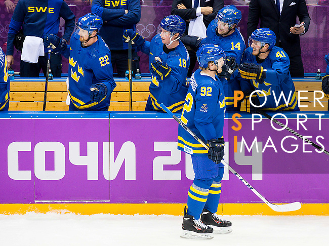 (L) Gabriel Landeskog of Sweden celebrates with his teammates during the match between Sweden vs Czech Republic during their Men's Ice Hockey Preliminary Round Group C game on day five of the 2014 Sochi Olympic Winter Games at Bolshoy Ice Dome on February 12, 2014 in Sochi, Russia. Photo by Victor Fraile / Power Sport Images