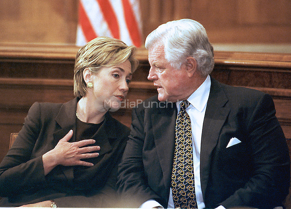 First lady Hillary Rodham Clinton and United States Senator Edward M. &quot;Ted&quot; Kennedy (Democrat of Massachusetts) talk to one another during a Capitol Hill press conference on September 28, 1999 in Washington, DC.  The press conference was called to discuss a new study by the Economic Policy Institute on the impact a minimum-wage increase would have on working women.  Both favor the increase.<br /> Credit: Ron Sachs / CNP/MediaPunch