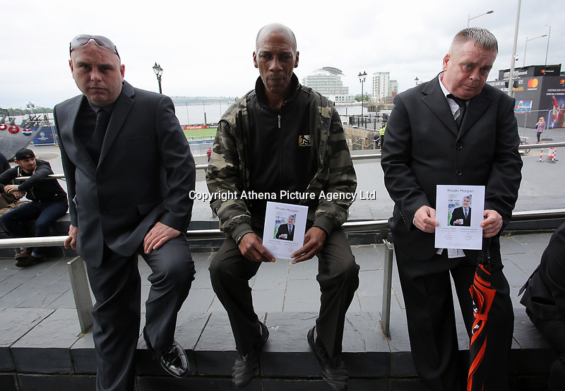 """Pictured: Some of the people that attended the service outside the Senedd. Wednesday 31 May 2017<br /> Re: The funeral for former first minister Rhodri Morgan has taken place in the Senedd in Cardiff Bay.<br /> The ceremony, which was open to the public, was conducted by humanist celebrant Lorraine Barrett.<br /> She said the event was """"a celebration of his life through words, poetry and music"""".<br /> Mr Morgan, who died earlier in May aged 77, served as the Welsh Assembly's first minister from 2000 to 2009.<br /> He was credited with bringing stability to the fledgling assembly during his years in charge.<br /> It is understood Mr Morgan had been out cycling near his home when he died."""