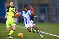 Kane Vincent-Young of Colchester United looks to get behind Jake Taylor of Exeter City during Colchester United vs Exeter City, Sky Bet EFL League 2 Football at the JobServe Community Stadium on 24th November 2018