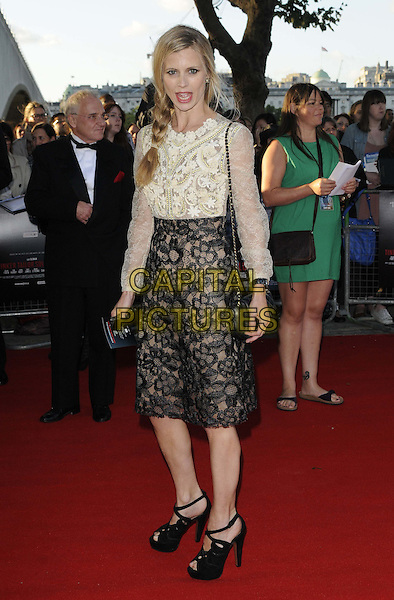 "LAURA BAILEY .The ""Tinker, Tailor, Soldier, Spy"" UK premiere, BFI  Southbank cinema, Belvedere Rd., London, England..September 13th, 2011.full length black lace skirt sandals shoes white cream blouse top sheer braid plait mouth open.CAP/CAN.©Can Nguyen/Capital Pictures."