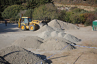 Pictured: A digger loads soil that has been searched in Kos, Greece. Wednesday 05 October 2016<br />