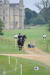 Australian groom Alex VanTuyll taking a tumble leading a horse during the Dressage phase of the 2014 Land Rover Burghley Horse Trials held at Burghley House, Stamford, Lincolnshire