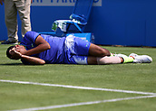 June 19th 2017, Queens Club, West Kensington, London; Aegon Tennis Championships, Day 1; Nick Kyrgios of Australia falls to the ground  as he injured himself attempting to play a forehand versus Donald Young of USA