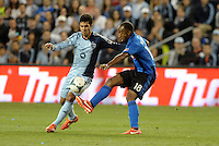 KANSAS CITY, KS - June 1, 2013:<br /> Benny Feilhaber (10) midfield Sporting KC ,  Colleen Warner (18) midfield Montreal Impact.<br /> Montreal Impact defeated Sporting Kansas City 2-1 at Sporting Park.
