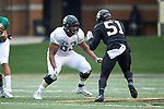 Je'Vionte' Nash (63) of the Wake Forest Gold Team prepares to block Chris Calhoun (51) of the Wake Forest Black Team during the Wake Forest Football Spring Game at BB&T Field on April 7, 2018 in Winston-Salem, North Carolina.  The Gold Team defeated the Black Team 26-6.  (Brian Westerholt/Sports On Film)