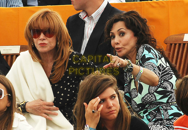 STEFANIE POWERS & MARIE HELVIN .At the Veuve Clicquot Cup Final 2008 in.Midhurst, England, July 20th 2008..half length hand pointing sunglasses stephanie .CAP/TTL .©TTL/Capital Pictures